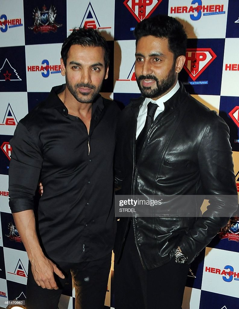 Indian Bollywood actors John Abraham and Abhishek Bachchan attend the mahurat (auspiciuous inauguration) of the forthcoming comedy Hindi film 'Hera Pheri 3' in Mumbai on January 12, 2015.