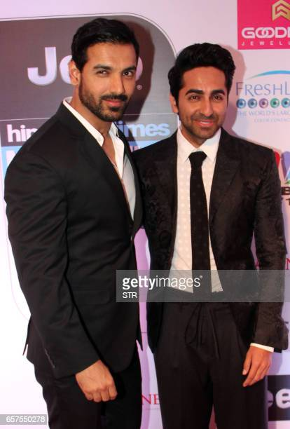 Indian Bollywood actors John Abraham and Ayushmaan Khurrana pose as they attend the 'HT Most Stylish' awards ceremony in Mumbai late March 24 2017...