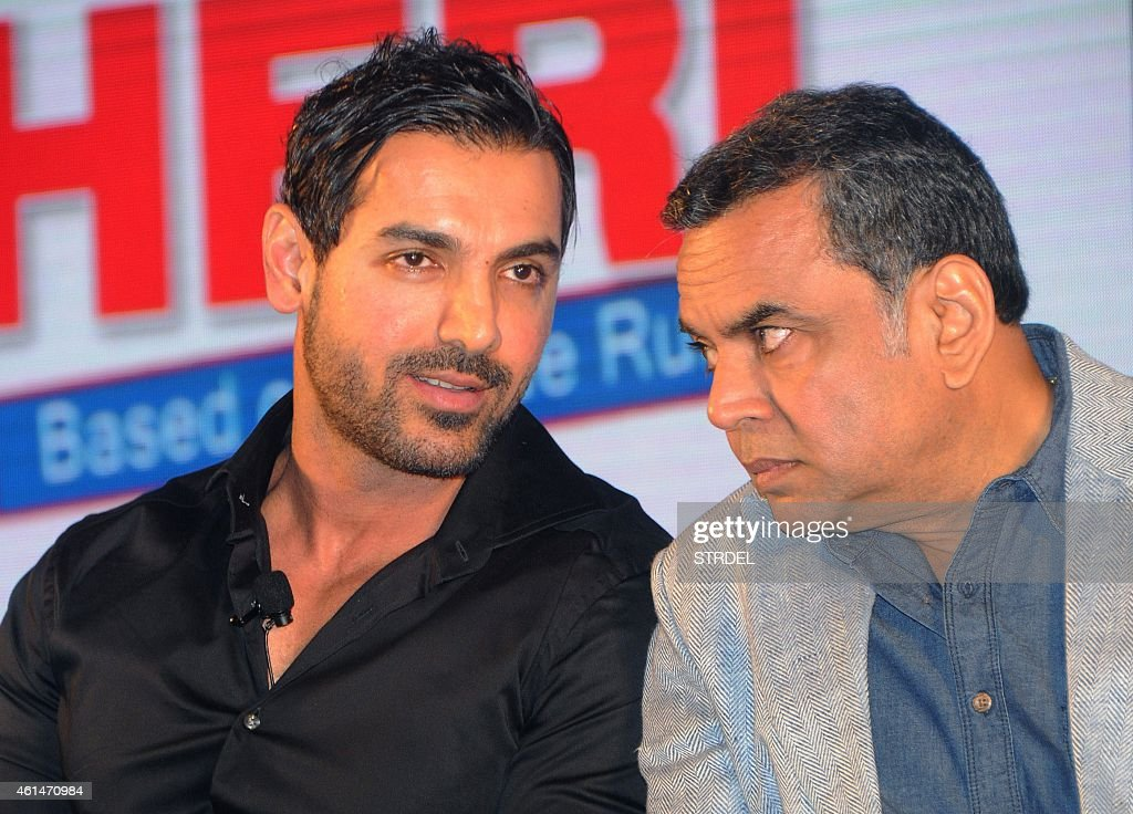 Indian Bollywood actors John Abraham (L) and Paresh Rawal attend the mahurat (auspiciuous inauguration) of the forthcoming comedy Hindi film 'Hera Pheri 3' in Mumbai on January 12, 2015.