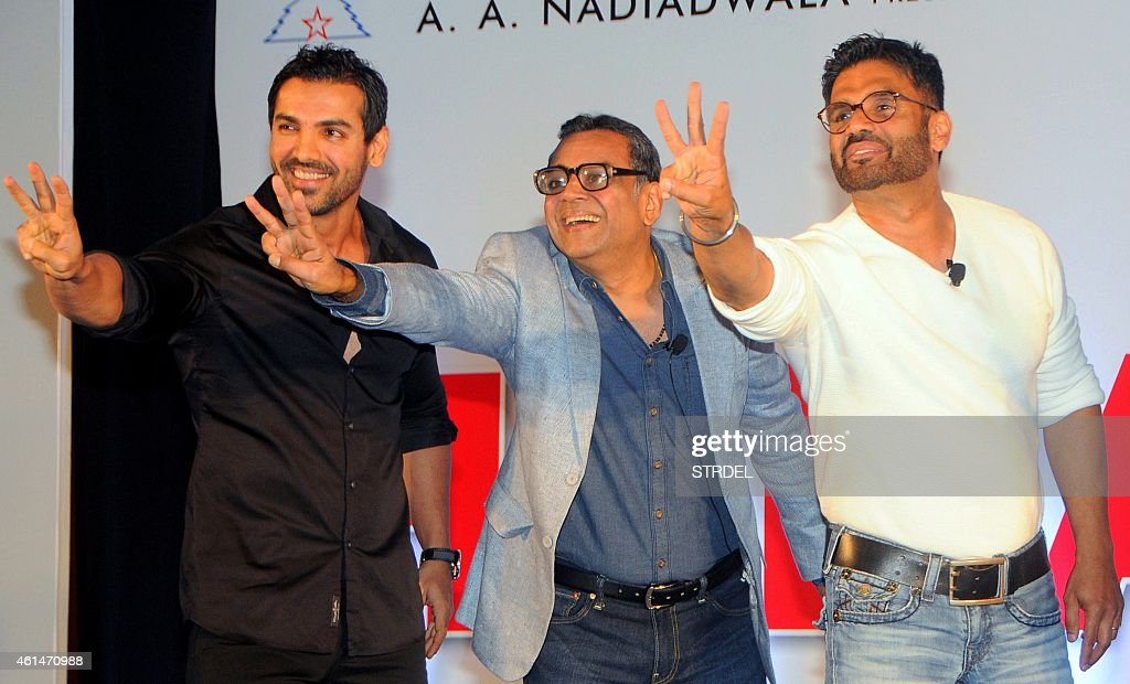 Indian Bollywood actors (L-R) <a gi-track='captionPersonalityLinkClicked' href=/galleries/search?phrase=John+Abraham+-+Sk%C3%A5despelare&family=editorial&specificpeople=11715593 ng-click='$event.stopPropagation()'>John Abraham</a>, Paresh Rawal and Suniel Shetty attend the mahurat (auspiciuous inauguration) of the forthcoming comedy Hindi film 'Hera Pheri 3' in Mumbai on January 12, 2015. AFP PHOTO/STR
