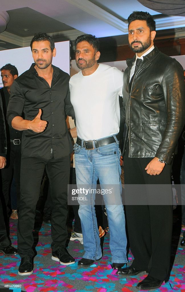 Indian Bollywood actors (L-R) John Abraham, Suniel Shetty and Abhishek Bachchan attend the mahurat (auspiciuous inauguration) of the forthcoming comedy Hindi film 'Hera Pheri 3' in Mumbai on January 12, 2015.