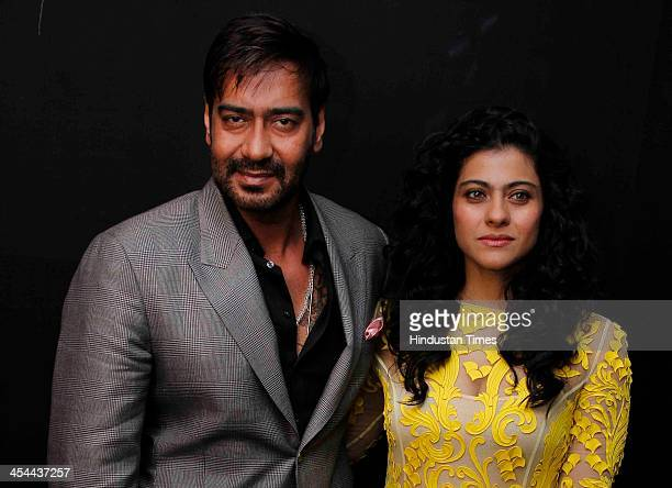 Indian bollywood actors Kajol and Ajay Devgan pose for their profile shoot at Taj Palace Hotel on December 6 2013 in New Delhi India Kajol and Ajay...