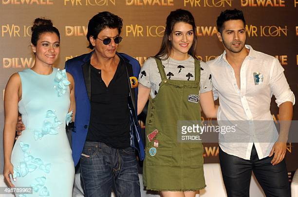 Indian Bollywood actors Kajol Devgn Shah Rukh Khan Kirti Sanon and Varun Dhawan pose for a photograph during a promotional event for the forthcoming...