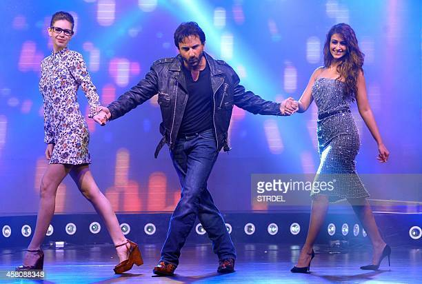 Indian Bollywood actors Kalki Koechlin Saif Ali Khan and Ileana D'Cruz onstage during the music launch of their upcoming Hindi film Happy Ending in...