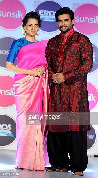 Indian Bollywood actors Kangana Ranaut and R Madhavan attend a party for the Hindi film Tanu Weds Manu Returns in Mumbai late on May 16 2015 AFP PHOTO