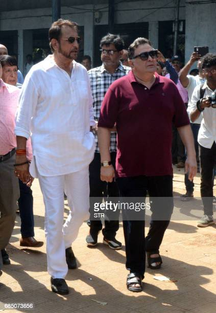 Indian Bollywood actors Kiran Kumar and Rishi Kapoor arrive to attend the funeral of veteran Bollywood Hindi and Marathi film actress Reema Lagoo in...