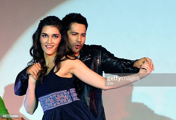 Indian Bollywood actors Kriti Sanon and Varun Dhawan make an appearance during the song launch of the upcoming Hindi film 'Dilwale' in Mumbai on...