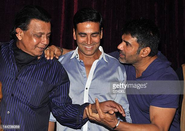 "Indian Bollywood actors Mithun Chakraborty Akshay Kumar and Suniel Shetty pose for a photo during launch of upcoming Hindi film ""Tukkaa Fitt""..."