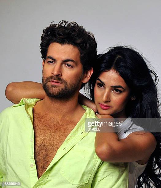 Indian Bollywood actors Neil Nitin Mukesh and Sonal Chauhan pose during a promotional photo shoot for the forthcoming Hindi film '3G' in Mumbai on...