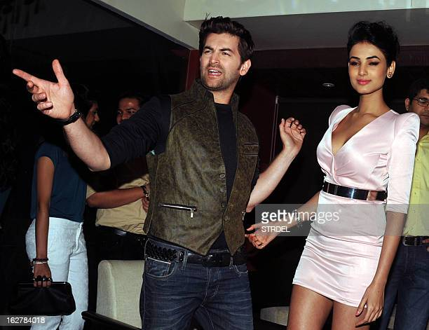Indian Bollywood actors Neil Nitin Mukesh and Sonal Chauhan pose during the soundtrack launch for the forthcoming Hindi film '3G' in Mumbai on...