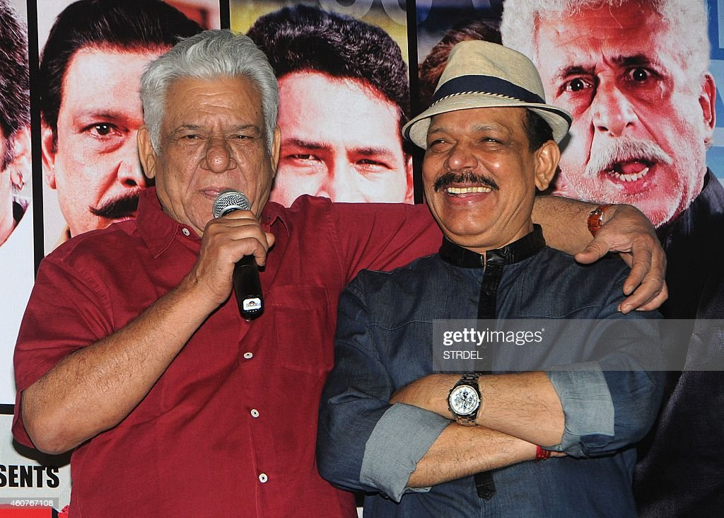 Indian Bollywood actors <a gi-track='captionPersonalityLinkClicked' href=/galleries/search?phrase=Om+Puri&family=editorial&specificpeople=1651238 ng-click='$event.stopPropagation()'>Om Puri</a> (L) and Govind Namdev during the trailer launch of their upcoming Hindi film Dirty Politics in Mumbai on December 21, 2014.