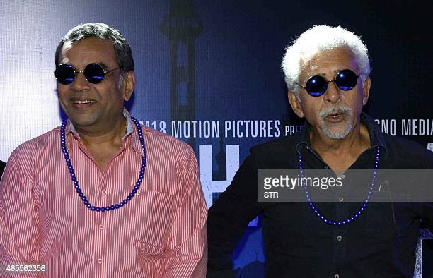 Indian Bollywood actors Paresh Rawal and Nasseruddin Shah look on during the trailer launch of their upcoming Hindi film Dharam Sankat Mein in Mumbai...