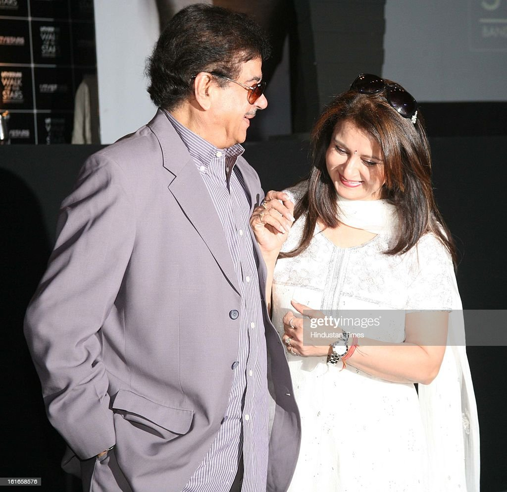 Indian bollywood actors Poonam Dhillon (R) and Shatrughan Sinha during the unveiling of Yash Chopra's statue by his wife Pamela Chopra at Yash Raj Studio on February 11, 2013 in Mumbai, India.