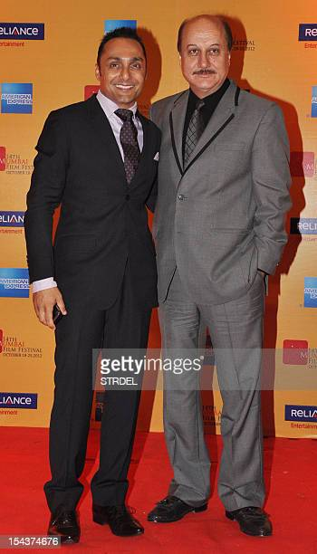Indian Bollywood actors Rahul Bose and Anupam Kher pose as they attend the opening ceremony for the 14th Mumbai Film Festival in Mumbai late October...