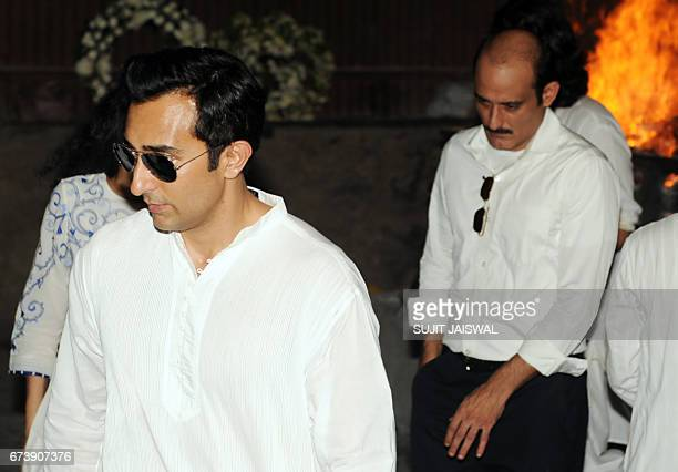Indian Bollywood actors Rahul Khanna and Akshaye Khanna attend the funeral of their father actor Vinod Khanna in Mumbai on April 27 2017 / AFP PHOTO...