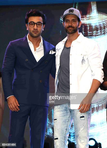 Indian Bollywood actors Ranbir Kapoor and Hrithik Roshan pose as they attend the Bright Awards 2017ceremony in Mumbai late February 6 2017 / AFP / STR