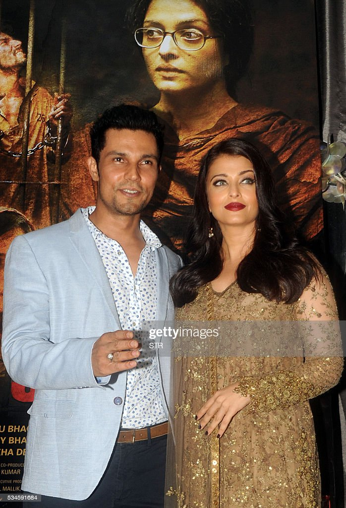 Indian Bollywood actors Randeep Hooda (L) and Aishwarya Rai Bachchan pose for a photograph during a promotional event for the forthcoming Hindi film 'Veerappan' in Mumbai on late May 26, 2016. / AFP / STR