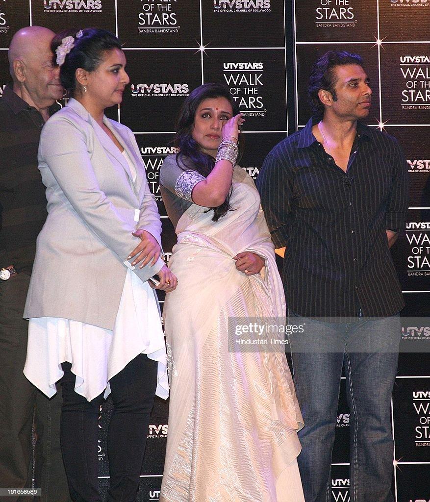 Indian bollywood actors Rani Mukherjee (C) and Uday Chopra (R) with dance choreographer Vaibhavi Merchant during the unveiling of Yash Chopra's statue by his wife Pamela Chopra at Yash Raj Studio on February 11, 2013 in Mumbai, India.