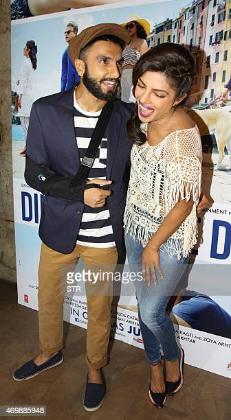 Indian Bollywood actors Ranveer Singh and Priyanka Chopra pose during the trailer showing of upcoming Hindi comedydrama film 'Dil Dhadakne Do'...