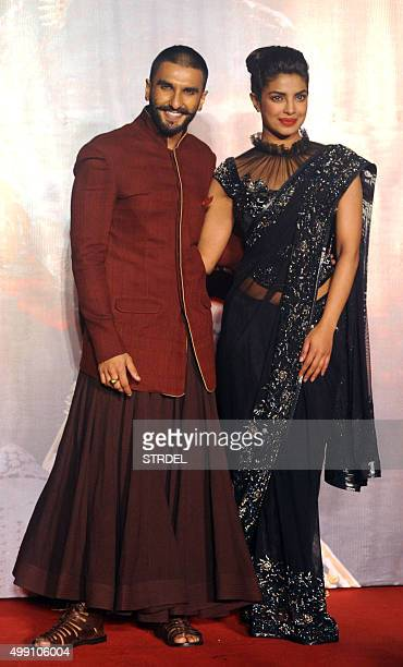Indian Bollywood actors Ranveer Singh and Priyanka Chopra pose for a photograph during a promotional event for the forthcoming Hindi film 'Bajirao...