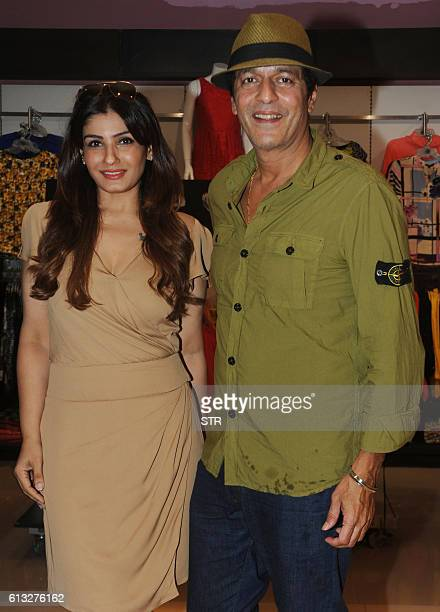 Indian Bollywood actors Raveena Tandon and Chunky Pandey pose for a photograph during a promotional event in Mumbai on late October 7 2016 / AFP / STR
