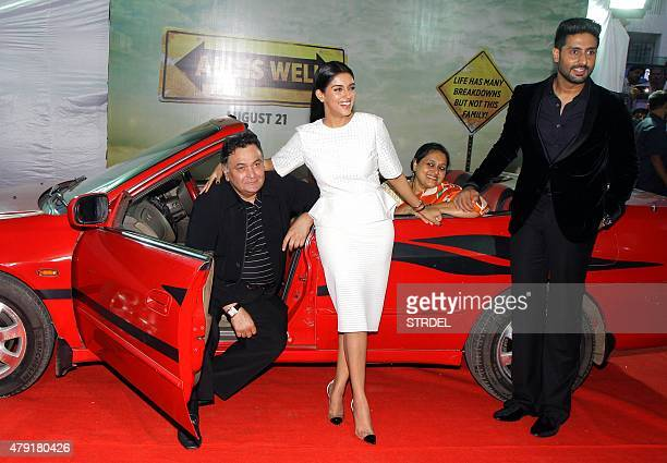 Indian Bollywood actors Rishi Kapoor and Abhishek Bachchan pose with actresses Asin Thottumkal and Supriya Pathak during the trailer launch of the...