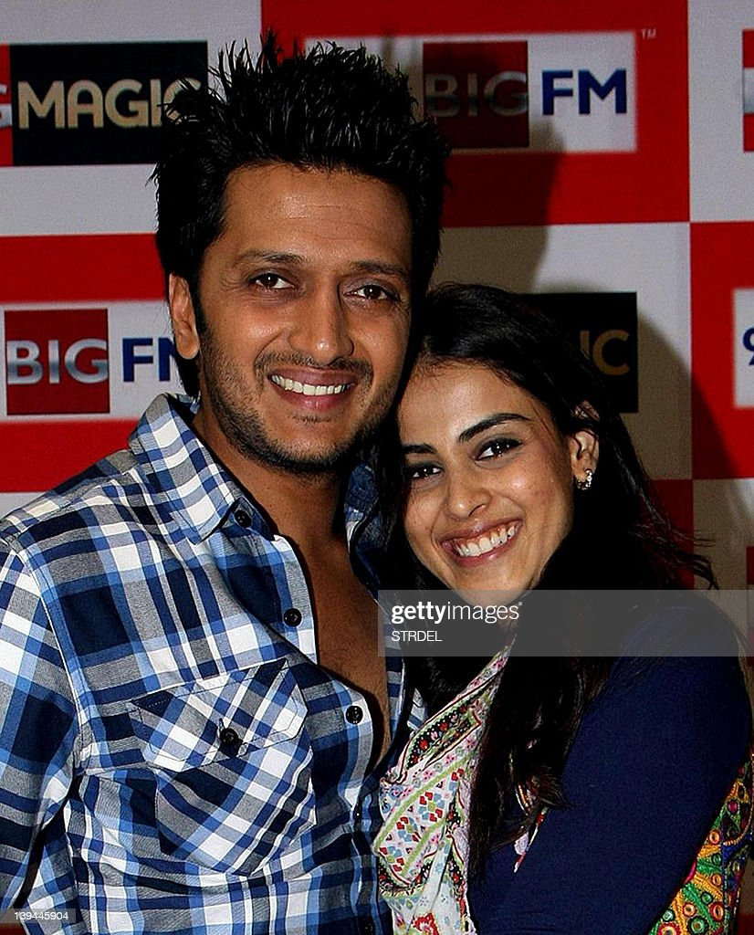 Indian Bollywood actors Ritesh Deshmukh with wife Genelia D'Souza pose during a promotional event for the film 'Tere Naal Love Ho Gaya' on the premises of 92.7 Big FM radio studio in Mumbai on February 21, 2012. AFP PHOTO/STR