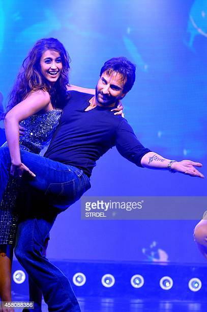 Indian Bollywood actors Saif Ali Khan and Ileana D'Cruz perform during the music launch of the upcoming Hindi film Happy Ending in Mumbai on October...