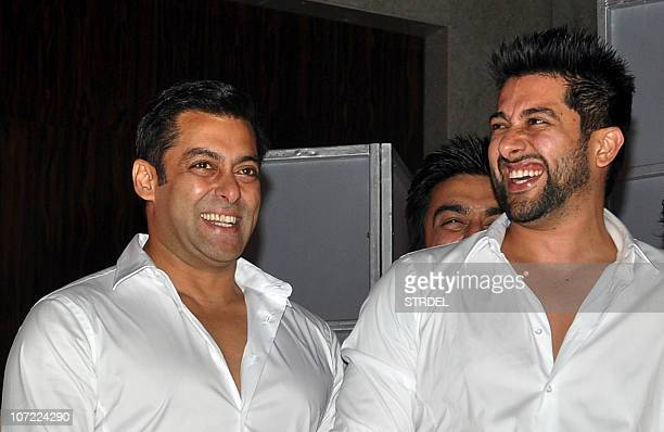 Indian bollywood actors Salman Khan and Aftab Shivdasani interact during a Celebrity Cricket League event in Mumbai on November 30 2010 AFP PHOTO/STR