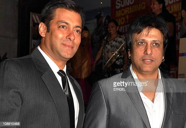 Indian Bollywood actors Salman Khan and Govinda attend the premier of Dev Anand's rerelease of old classic hindi film 'Hum Dono' premier in Mumbai on...