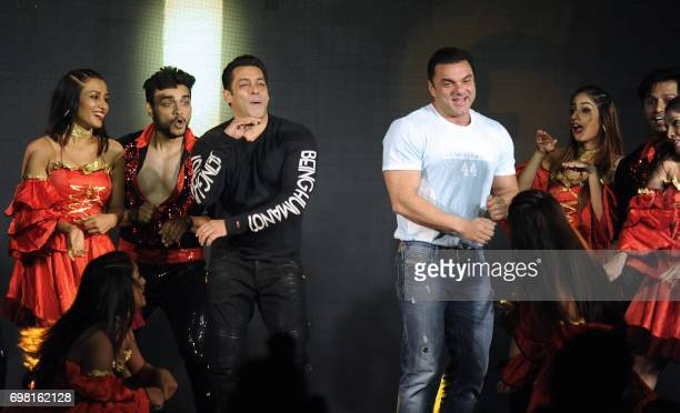Indian Bollywood actors Salman Khan and Sohail Khan dance during the promotion of their upcoming Hindi film Tubelight in Mumbai on late June 19 2017...