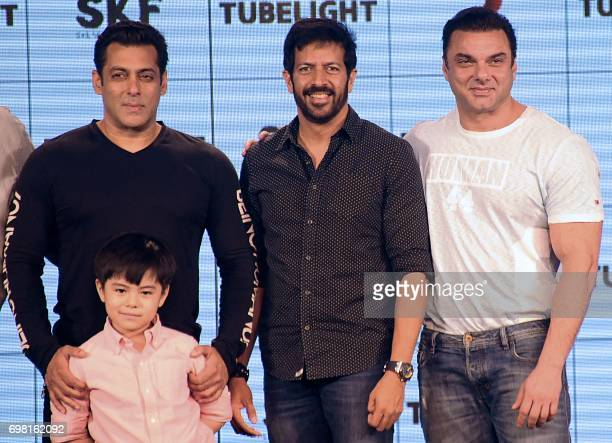 Indian Bollywood actors Salman Khan Sohail Khan and child actor Martin Rey Tunga pose for a photo during the promotion of their upcoming Hindi film...