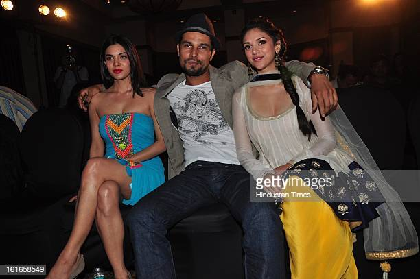 Indian bollywood actors Sara Loren and Randeep Hooda with Aditi Rao Hydari during a press conference for a 'Murder 3' movie promotion at JW Marriott...