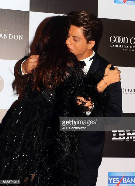 Indian Bollywood actors Shah Rukh Khan and Aishwarya Rai Bachchan embrace during the 10th edition of the 'Vogue Women of the Year Awards' event in...