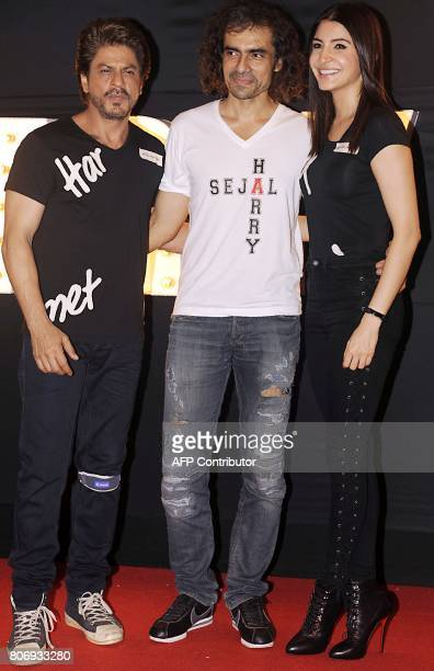 Indian Bollywood actors Shah Rukh Khan and Anushka Sharma pose for a photograph during a promotional event for the forthcoming Hindi film 'Jab Harry...