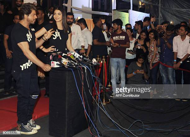 Indian Bollywood actors Shah Rukh Khan and Anushka Sharma speak to media during a promotional event for the forthcoming Hindi film 'Jab Harry Met...
