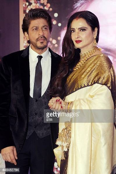 Indian Bollywood actors Shah Rukh Khan and Rekha pose for a photograph during the National Yash Chopra Memorial Awards in Mumbai on late February 25...