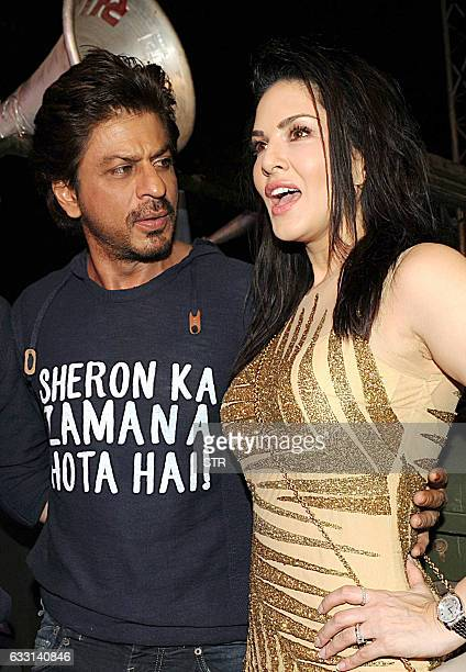 Indian Bollywood actors Shah Rukh Khan and Sunny Leone take part in a promotional event for the Hindi film 'Raees' in Mumbai on late January 30 2017...
