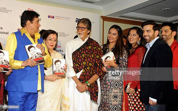 Indian Bollywood actors Shatrughan Sinha and Amitabh Bachchan pose for a photograph alongside relatives and guests during a promotional event in...