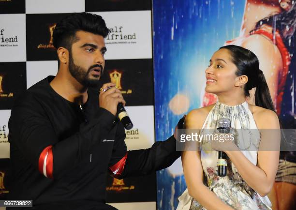 Indian Bollywood actors Shraddha Kapoor and Arjun Kapoor attend the trailer launch of the Hindi film 'Half Girlfriend' in Mumbai on April 10 2017...