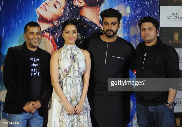 Indian Bollywood actors Shraddha Kapoor Arjun Kapoor writer Chetan Bhagat and director Mohit Suri attend the trailer launch of the Hindi film 'Half...