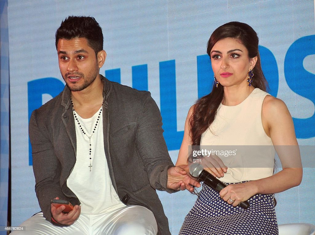 Indian Bollywood actors Soha Ali Khan with her husband Kunal Khemu attend an event for a line of electronics in Mumbai on April 7 2015 AFP PHOTO