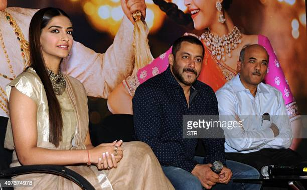 Indian Bollywood actors Sonam Kapoor and Salman Khan and director Sooraj R Barjatya attend a promotional event for the Hindi film 'Prem Ratan Dhan...