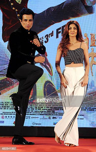 Indian Bollywood actors Sonu Sood and Shilpa Shetty attend a promotional event for the upcoming film 'Kung Fu Yoga' in Mumbai on January 23 2017 /...