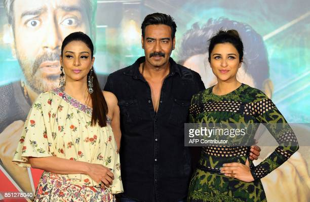 Indian Bollywood actors Tabu Ajay Devgan and Parineeti Chopra attend the trailer launch of their upcoming Hindi film 'Golmaal Again' in Mumbai on...