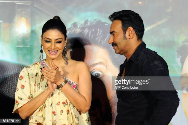 Indian Bollywood actors Tabu and Ajay Devgan attend the trailer launch of their upcoming Hindi film 'Golmaal Again' in Mumbai on September 22 2017 /...