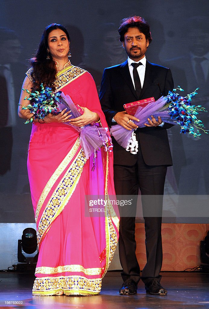 Indian Bollywood actors Tabu (L) and Irrfan Khan, cast in the film 'Life of Pi', are pictured onstage during the inauguration of the 43rd International Film Festival of India (IFFI) at Campal in Panaji on November 20, 2012.