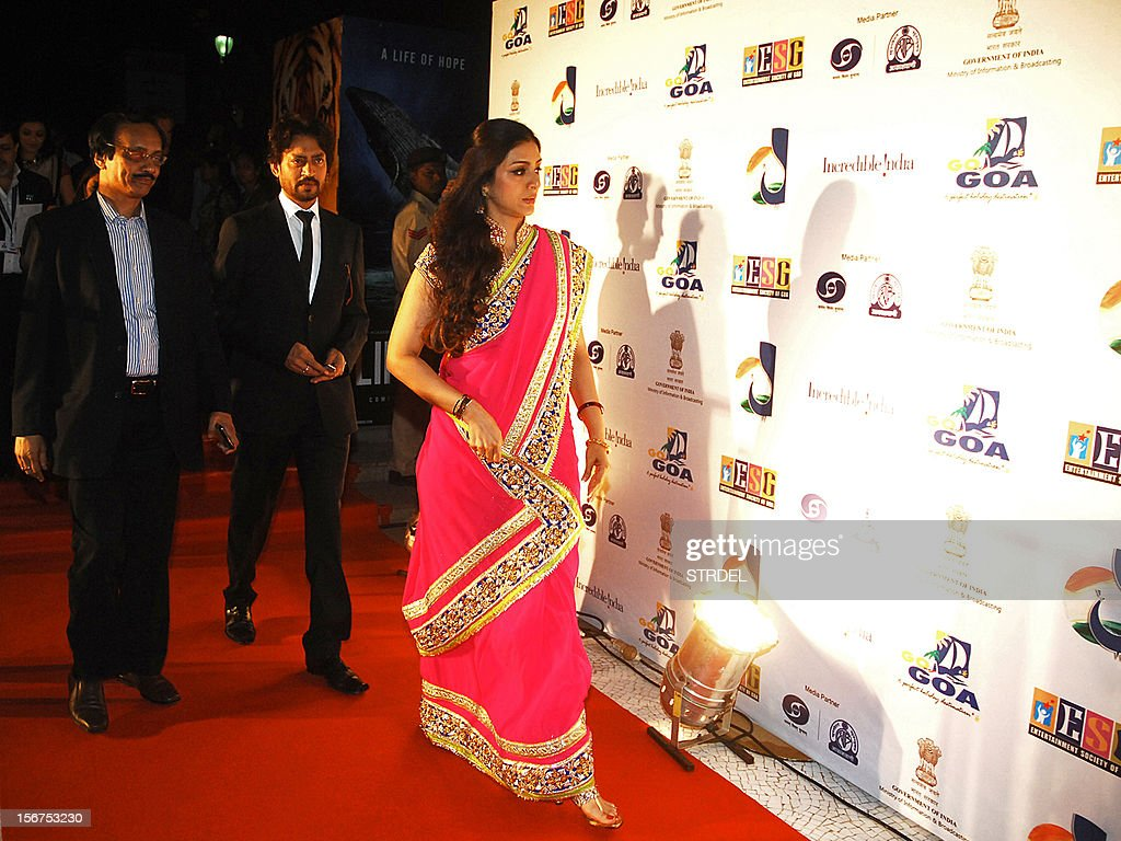 Indian Bollywood actors Tabu (R) and Irrfan Khan (C), cast in the film 'Life of Pi', walk on the red carpet as they arrive for the inauguration of the 43rd International Film Festival of India (IFFI) at Campal in Panaji on November 20, 2012.