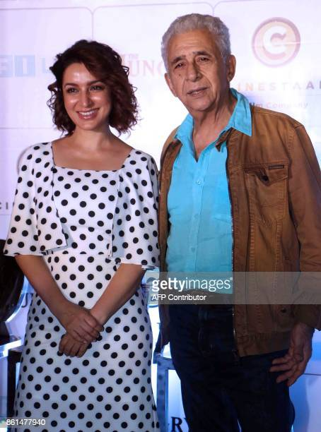 Indian Bollywood actors Tisca Chopra and Naseeruddin Shah pose for a picture during the promotion of their Hindi film 'The Hungry' in Mumbai late on...