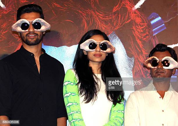 Indian Bollywood actors Vicky Kaushal Sobhita Dhuliwala and Nawazuddin Siddiqui pose for a photograph during a promotional event for the forthcoming...